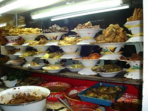 How 'bout we stop at a Padang restaurant for lunch – my treat?
